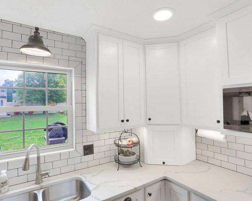 White corner appliance garage lift up door