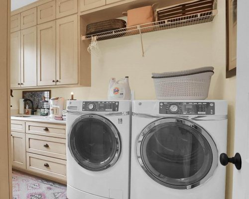 Laundry folding area storage cabinetry